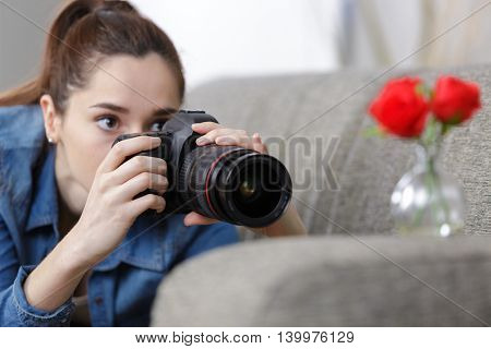 portrait of a beautiful girl with a camera taking photos