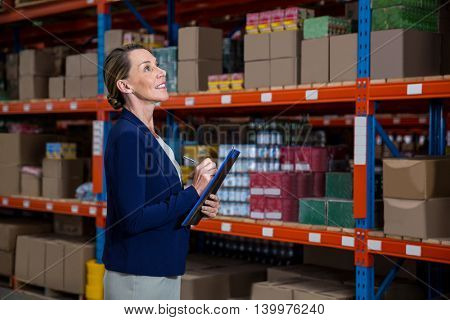 Business woman is concentrating during his work in a warehouse
