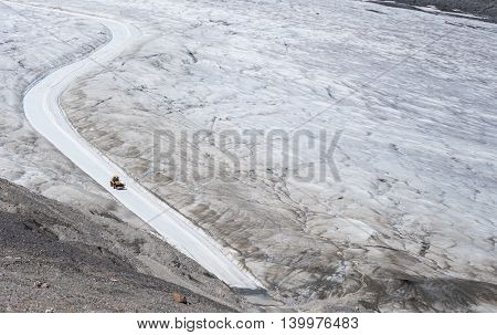 Tractor Clears the Way on Athabasca Glacier