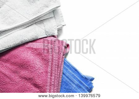 Colorful bath towels folded on white background