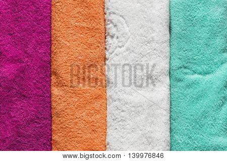 Group of colorful terry towels as a background