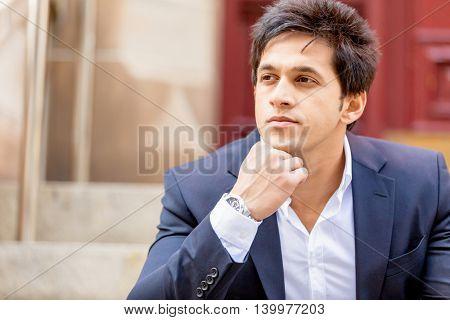 Portrait of confident businessman outdoors