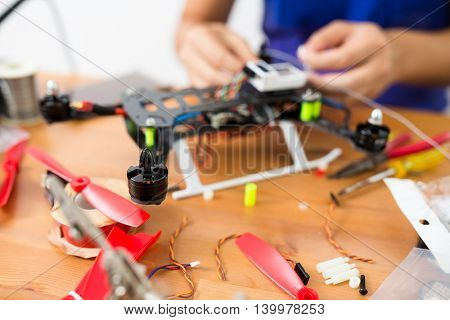 Man working on toy helicopter