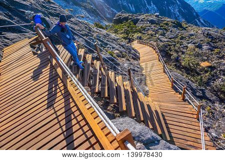 Ranau,Sabah, Borneo-March 13,2016: Wooden stairs up to summit of mountain Kinabalu.On 1st December 2015,the new Mount Kinabalu Summit Trail was officially opened to climbers from all over the world.