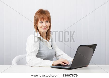 Happy Girl With A Laptop
