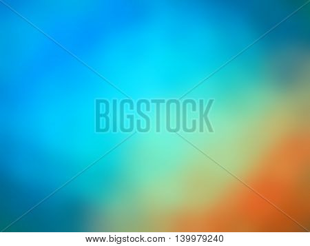 Abstract rainbow gradient orange green blue colored blurred background.