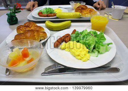 Breakfast delicious food omelet sausage vegetable orange juice croissant banana and fruit