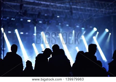 Stage Lights. Concert Scene With Crowd In Foreground