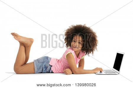 Happy African girl with laptop, isolated on white