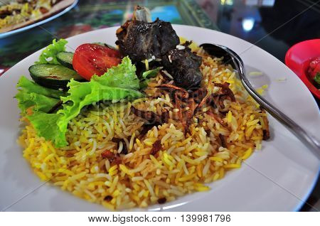 Kabsa savory rice with herbs typical and delicious