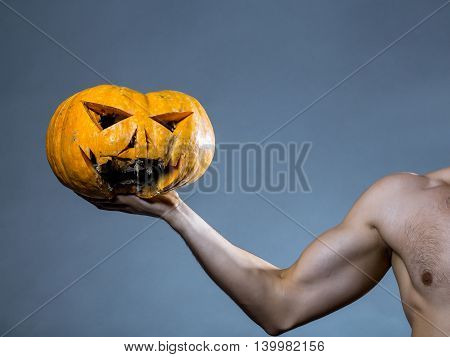 Muscular Male Hand With Pumpkin