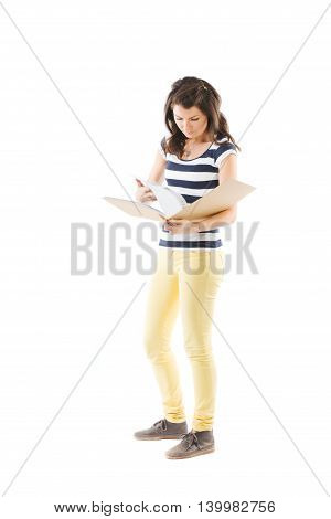 Young woman holding a scrapbook and turning the pages - isolated on white