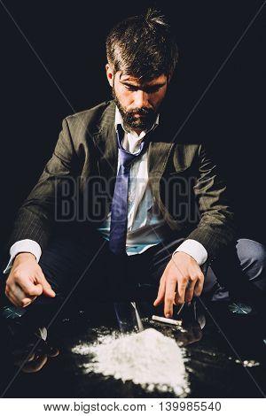 Pose of men preparing to sniff cocaine