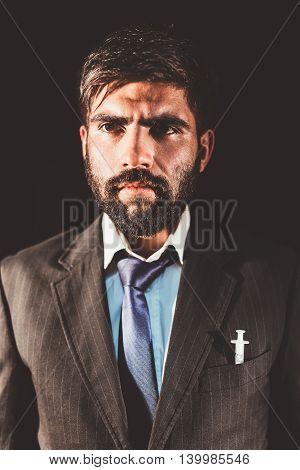 Businessman and drug addict having a syringe in his pocket having a strange lost look