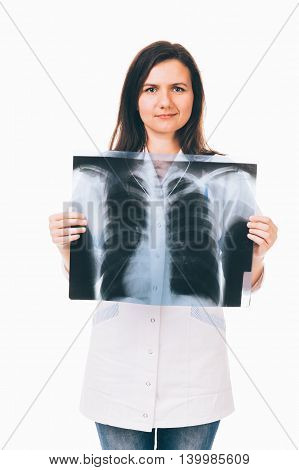 Female doctor is holding lung radiography in front of her chest - isolated on white