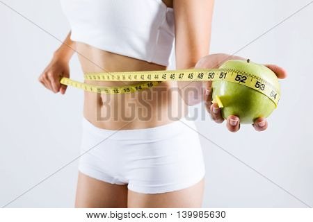 Woman Measuring Her Slim Body. Isolated On White Background.
