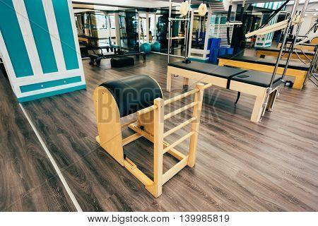 Trapeze table reformer ladder barrelexochair in a pilates room