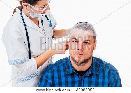 Nurse applying a bandage to a man who had a head trauma