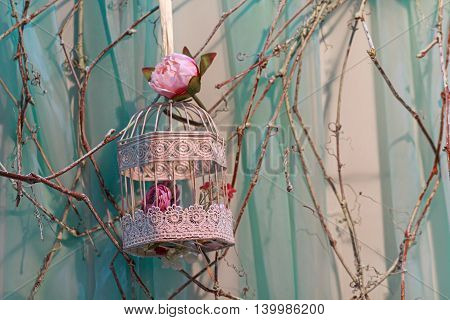 Roses and beautiful vintage bird's cage. Wedding decor