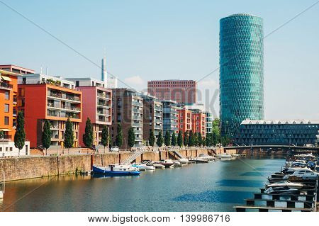 View of the Westhafen tower apartment buildings and marina in Frankfurt Germany
