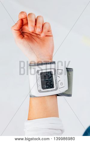 Medical equipment : digital blood pressure monitor - isolated on white.