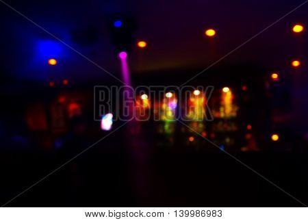 colorful spot light in club at dark night background