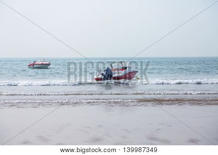 two boats floating at the beach,china.