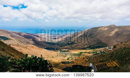 Lanzarote landscape in the mountains with small town and roads