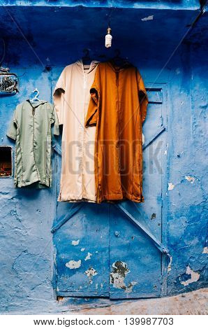 Traditional moroccan berber robes for sale in Chefchaouen small city painted in blue from Morocco