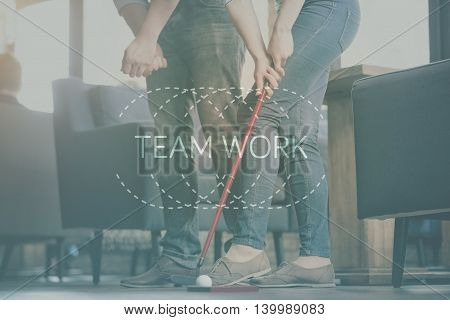 Togetherness. Inspirational typographic quote about teamwork with cropped image of two friends playing golf indoors in a background