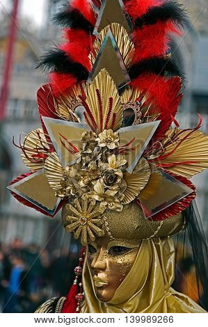 VENICE ITALY - JANUARY 24 2016: An unidentified person in a carnival costume attends at the Carnival of Venice January 24 2016 in Venice Italy.