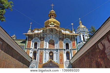 Entrance to Kiev-Pechersk Lavra monastery from Mazepa street. The walls are decorated with rich carvings and paintings, Kyiv, Ukraine