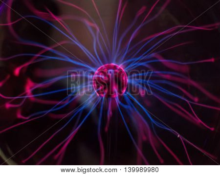 Plasma ball in action over dark background