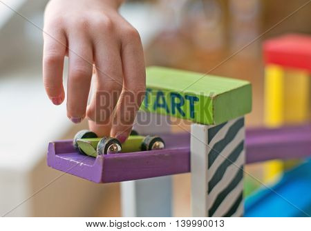 Child hand playing with the toy blocks.