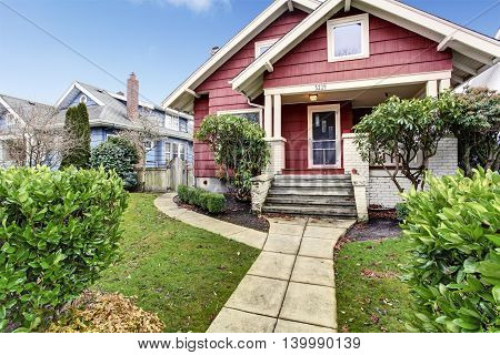 Classic Craftsman Old American House Exterior In Red And White.