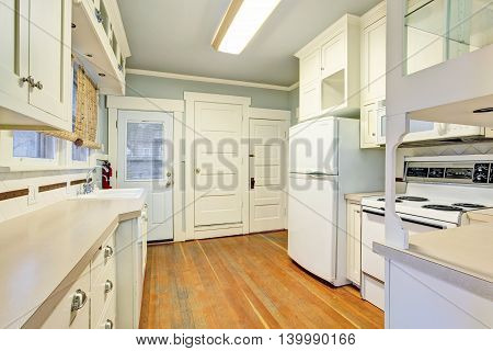 White Empty Simple Old Kitchen Room With Hardwood Flooring