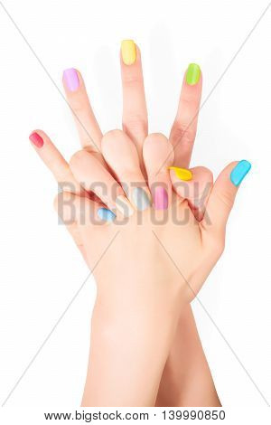 Young woman hands with bright colored nails. Isolated on white with clipping path