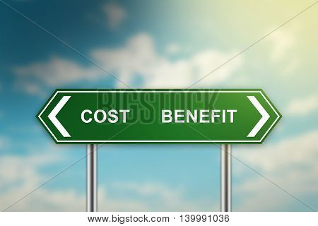 cost and benefit on green road sign with blurred blue sky dark and bright side concept