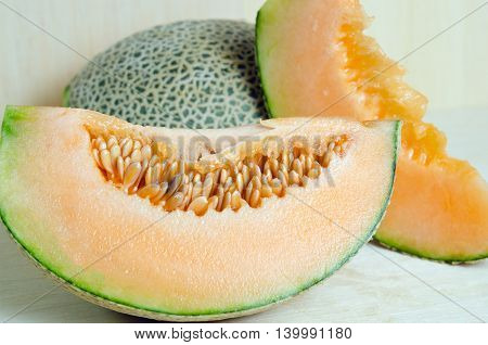 Cucumis Melo Or Melon With Half And Seeds On Wooden Plate (other Names Are Cantelope, Cantaloup, Hon