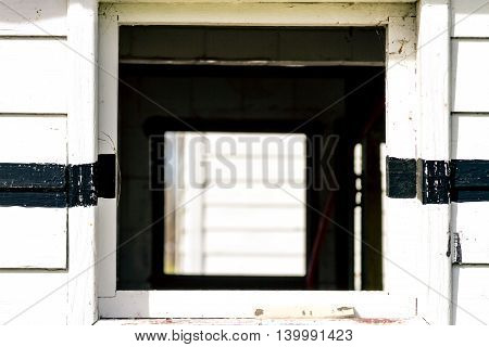 White rustic wood wall with window and lines
