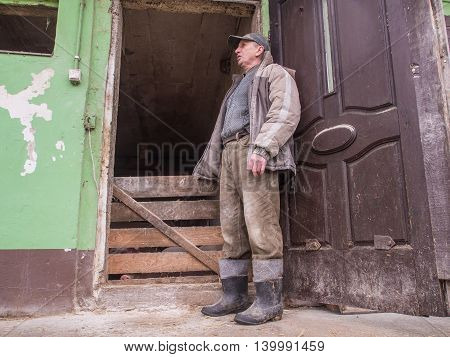 Bobrek Poland - February 10 2016: A polish farmer standing in front of a pigstay