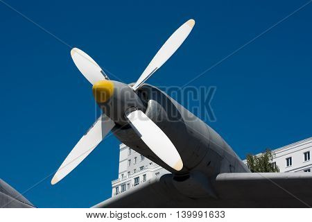 Propeller of the plane on a background of blue sky.