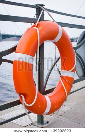 Orange lifebuoy of fast safety. Safety concept.