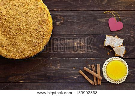 Honey cake on a dark wooden background. The top view.
