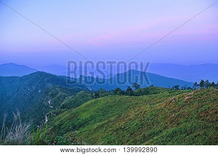 Beautiful shading of green to blue mountainous with colorful purple background