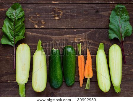 Freshly picked vegetables on a wooden background. top view