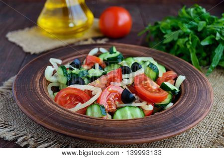 Dietary salad with vegetables olives and oil. Mediterranean Kitchen.