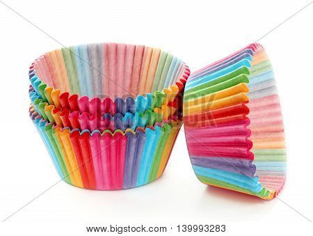 Colorful cupcakes paper packaging isolated on white background