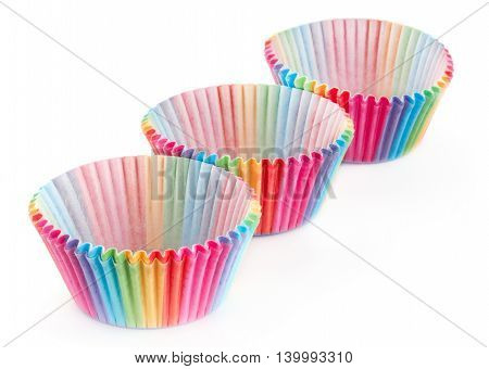 Baking cups for muffins isolated on white background