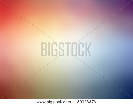 Abstract gradient rainbow red blue yellow purple colored blurred background.